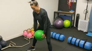 Client performing the dead ball lift at Fortify Fitness